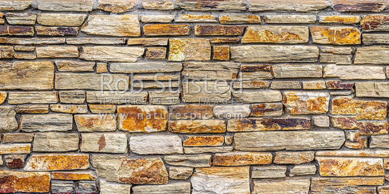 Schist Rock Wall Panorama. Schist Rock Layered Into Decorative Stone Wall.  Red Schist,