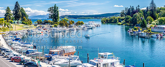 Lake Taupo marina with boats and yachts on the start of the Waikato River. Tongariro National Park and Acacia Bay beyond. Panorama, Taupo, Taupo District, Waikato Region, New Zealand (NZ) stock photo.