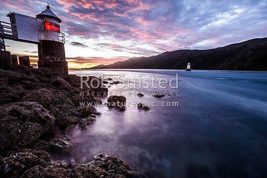 French Pass lighthouse standing over Te Aumiti channel between D'Urville Island and mainland, French Pass, Marlborough District, Marlborough Region, New Zealand (NZ) stock photo.
