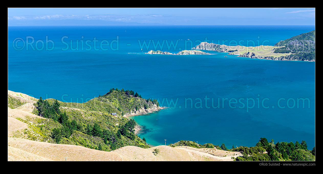Image of Tasman Bay seen from French Pass above Camp Bay. Sailboat passing Le Brun Peninsula, Hautai Island and D'Urville Island. Separation Point is distance. Panorama, French Pass, Marlborough Sounds, Marlborough District, Marlborough Region, New Zealand (NZ) stock photo image