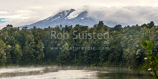 Lake Rotokura nestled amongst forest under Mount (Mt) Ruapehu. Sacred tapu site for Ngati Rangi, tangata whenua. Panorama, Karioi, Ruapehu District, Manawatu-Wanganui Region, New Zealand (NZ) stock photo.