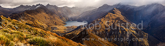 Lochnagar (Lake Lochnagar) above the Shotover River, in the Richardson Mountains and Shotover Conservation Area. Cleft Peak (2250) in cloud, Glencairn Spur left. Panorama, Shotover River, Queenstown Lakes District, Otago Region, New Zealand (NZ) stock photo.