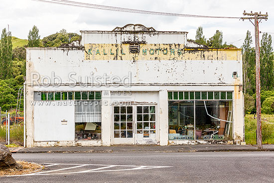 Kallil Motors building 1928, that has seen better days in Ohura township, Ohura, Ruapehu District, Manawatu-Wanganui Region, New Zealand (NZ) stock photo.