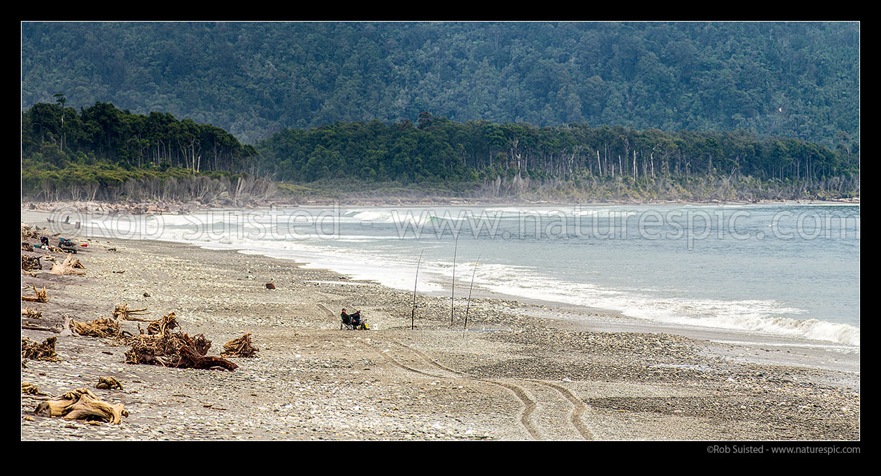 Image of Maori Beach near Mahitahi River mouth, with fishermen on beach. Panorama, Bruce Bay, Westland District, West Coast Region, New Zealand (NZ) stock photo image
