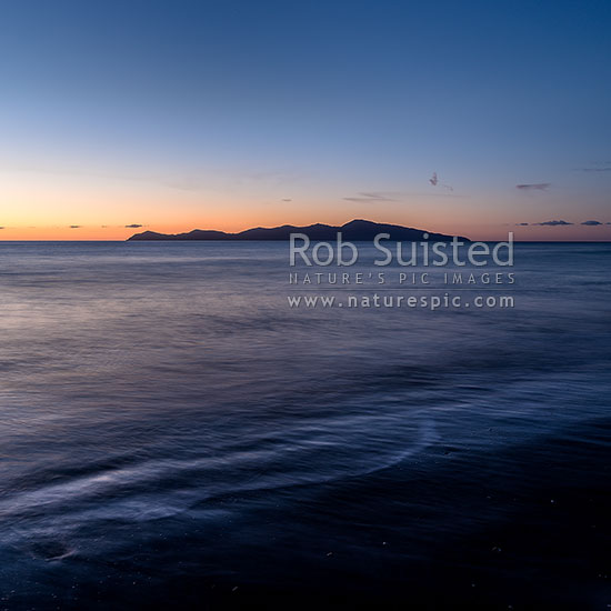 Kapiti Island at dusk, seen from Paekakariki Beach. Square format, Paekakariki, Kapiti Coast District, Wellington Region, New Zealand (NZ) stock photo.