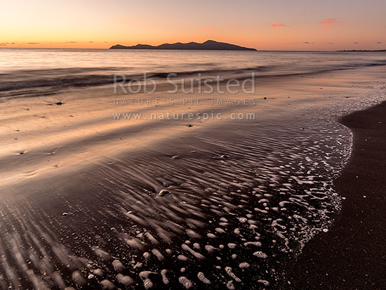 Paekakariki's Beach at sunset, with Kapiti Island behind. Whareroa Beach, Paekakariki, Kapiti Coast District, Wellington Region, New Zealand (NZ) stock photo.