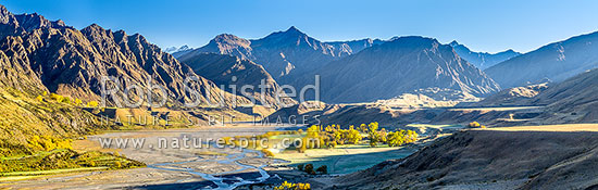 The Branches Station in the upper Shotover River Valley. Mt Greenland (1906m) centre above airstrip and station complex. Panorama, Branches Station, Shotover Valley, Queenstown Lakes District, Otago Region, New Zealand (NZ) stock photo.