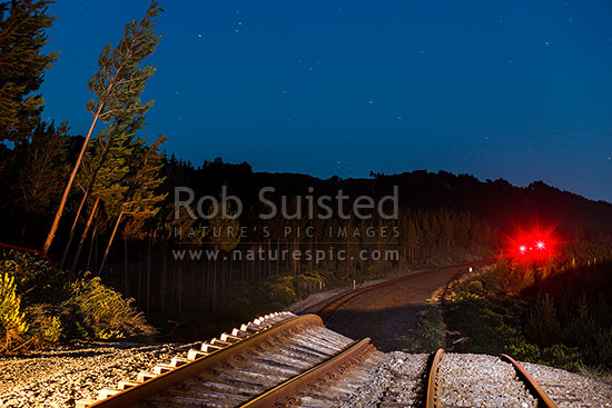 Railway tracks heaved up over 5 metres by the Papatea Fault rupture, leaving a major hill and curve in the previously flat parallel tracks. Kaikoura M7.8 earthquake, Waipapa Bay, Kaikoura District, Canterbury Region, New Zealand (NZ) stock photo.