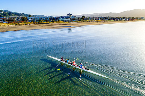 Petone Beach rowing team returning to shore after early morning training sculling. Aerial view at dawn, Petone, Hutt City District, Wellington Region, New Zealand (NZ) stock photo.