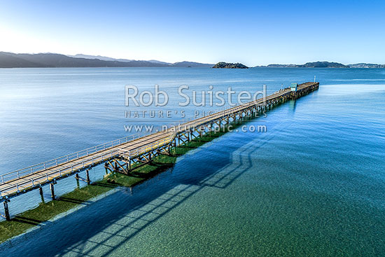 Petone Wharf, with Matiu / Somes Island beyond on Wellington Harbour. Aerial view, Petone, Hutt City District, Wellington Region, New Zealand (NZ) stock photo.