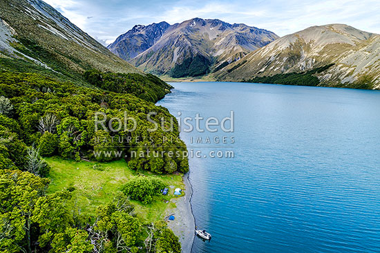 Lake Tennyson seen from above, with a fisher's or boatie's camping tent site on shoreline. Crimea Range and Crystal Peak (2020m) beyond. Aerial view, Molesworth Station, Hurunui District, Canterbury Region, New Zealand (NZ) stock photo.