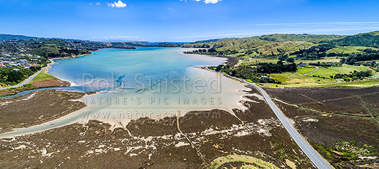 Pauatahanui Inlet of Porirua Harbour from air. Pauatahanui Stream and Whitby far left, Wildlife Reserve below, and Grays Road, Ration Point right. Aerial view panorama, Pauatahanui, Porirua City District, Wellington Region, New Zealand (NZ) stock photo.