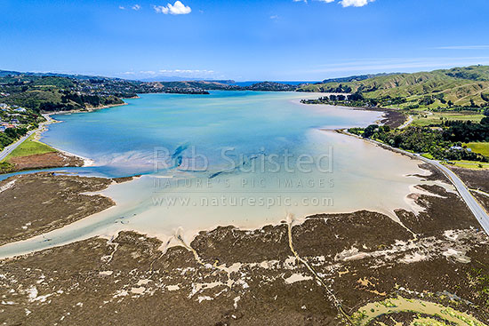 Pauatahanui Inlet of Porirua Harbour from air. Pauatahanui Stream and Whitby far left, Wildlife Reserve below, and Grays Road, Ration Point right. Aerial view, Pauatahanui, Porirua City District, Wellington Region, New Zealand (NZ) stock photo.