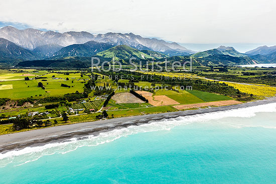 Hapuku River coastal fan. Seaward Kaikoura Ranges showing active debris dust from Kaikoura m7.8 earthquake behind. Hapuku River alluvial delta, Hapuku River, Kaikoura District, Canterbury Region, New Zealand (NZ) stock photo.