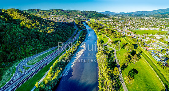 Hutt River in the Upper Hutt valley near Trentham. River Road (SH2) crossed the Hutt River with Riverstone Terraces far left, Moonshine Park and Upper Hutt City right. Tararua Ranges beyond. Aerial panorama, Upper Hutt, Wellington Region, New Zealand (NZ) stock photo.