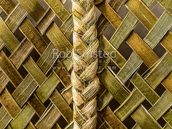 Woven flax in traditional Maori style using flax (Harakeke) leaves and fibre to weave into items of use. Criss cross weaving and joining technique, New Zealand (NZ) stock photo.