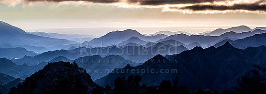 Awatere River valley moody dawn, with ridgelines of Gladstone Downs and Camden Stations. Hodder River, Cam and Isis stream close by. Cook Strait beyond. Panorama, Awatere Valley, Marlborough District, Marlborough Region, New Zealand (NZ) stock photo.