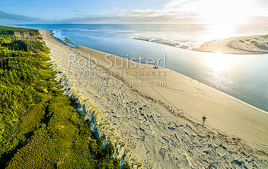 Manawatu River mouth with people surfcasting and fishing on the southern Waitarere side. Aerial view, Foxton Beach, Horowhenua District, Manawatu-Wanganui Region, New Zealand (NZ) stock photo.