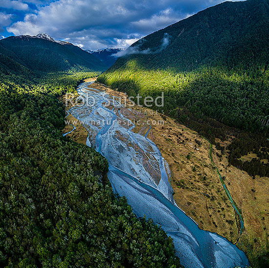 Maruia River flats below Lewis Pass. Aerial view of braided river flats and beech forest. Mt Mueller (1630m) and Freyberg Range at left, Opera Range and Spenser Mountains beyond. Square format, Maruia Springs, Buller District, West Coast Region, New Zealand (NZ) stock photo.