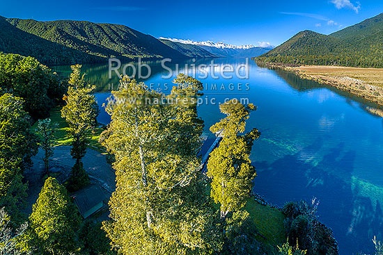 Lake Rotoroa, with Muntz Range left, and Travers Range at head of lake in snow, Gowan River outlet at right. Aerial view above boat ramp and jetty, Nelson Lakes National Park, Tasman District, Tasman Region, New Zealand (NZ) stock photo.