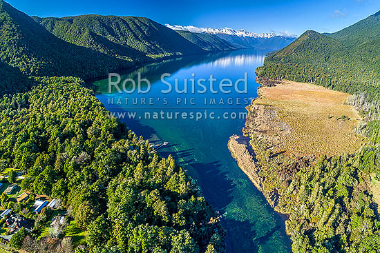 Lake Rotoroa in Nelson Lakes National Park. Travers Range at lake head covered in winter snow. Muntz Range at left. Aerial view over boat ramp and jetty, and Gowan River outlet, Nelson Lakes National Park, Tasman District, Tasman Region, New Zealand (NZ) stock photo.
