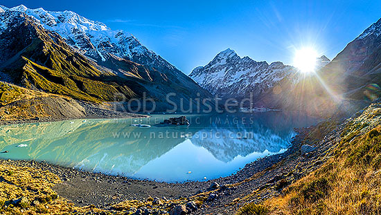 Hooker Lake with Aoraki / Mt Cook (3754m) beyond.  Sun rising over the Mount Cook Range, and Hooker Glacier and valley, Aoraki / Mount Cook National Park, MacKenzie District, Canterbury Region, New Zealand (NZ) stock photo.