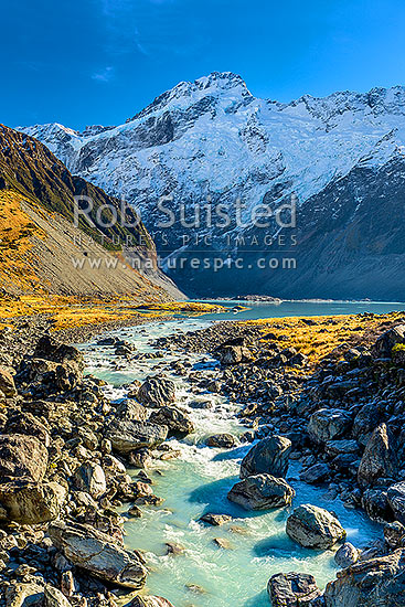 Mt Sefton (3151m) above the Mueller Glacier lake and valley, with Hooker River rushing past. Southern Alps, Main Divide, Aoraki / Mount Cook National Park, MacKenzie District, Canterbury Region, New Zealand (NZ) stock photo.