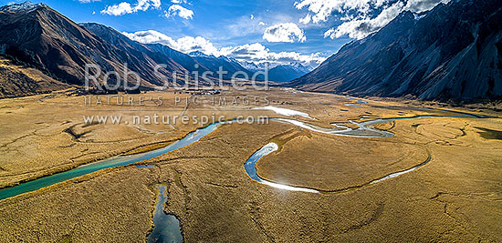 Ahuriri River Valley headwaters with lakes, tarns and ponds on flats. Broad braided river valley, now in Ahuriri Conservation Park. Aerial panorama upstream from Birchwood Station, Ahuriri River, Waitaki District, Canterbury Region, New Zealand (NZ) stock photo.