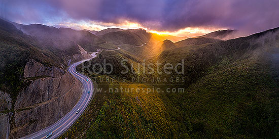 Remutaka (Rimutaka) Hill Road (State Highway 2, SH2) climbing over the Remutaka (Rimutaka) Ranges (to 555m) from Upper Hutt to the Wairarapa. Aerial panorama on a moody evening, Remutaka, Upper Hutt City District, Wellington Region, New Zealand (NZ) stock photo.