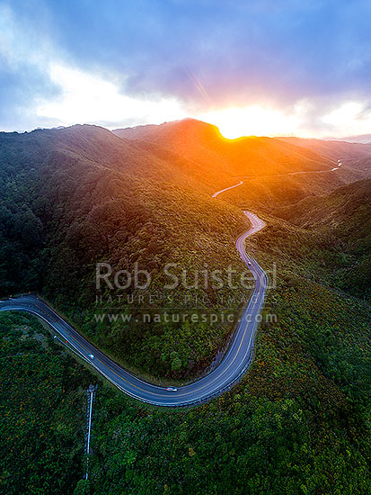 Remutaka (Rimutaka) Hill Road (State Highway 2, SH2) climbing over the Remutaka (Rimutaka) Ranges (to 555m) from Upper Hutt to the Wairarapa. Aerial view on a moody evening, Remutaka, Upper Hutt City District, Wellington Region, New Zealand (NZ) stock photo.