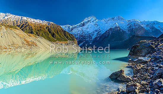 Mt Sefton (3151m centre) and Footstool (2764m right) above the Mueller Glacier lake and valley. Southern Alps, Main Divide. Panorama, Aoraki / Mount Cook National Park, MacKenzie District, Canterbury Region, New Zealand (NZ) stock photo.
