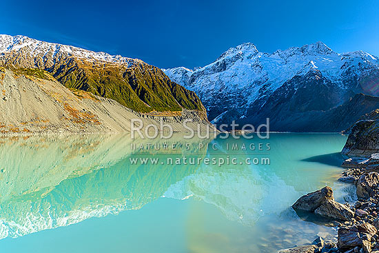 Mt Sefton (3151m centre) and Footstool (2764m right) above the Mueller Glacier lake and valley. Southern Alps, Main Divide, Aoraki / Mount Cook National Park, MacKenzie District, Canterbury Region, New Zealand (NZ) stock photo.