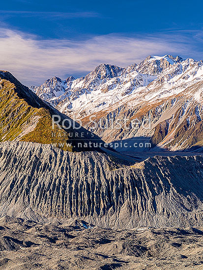 Murchison Valley (right) across the Tasman Glacier and lateral moraine. Malte Brun Range left, Liebig Range at right, Aoraki / Mount Cook National Park, MacKenzie District, Canterbury Region, New Zealand (NZ) stock photo.