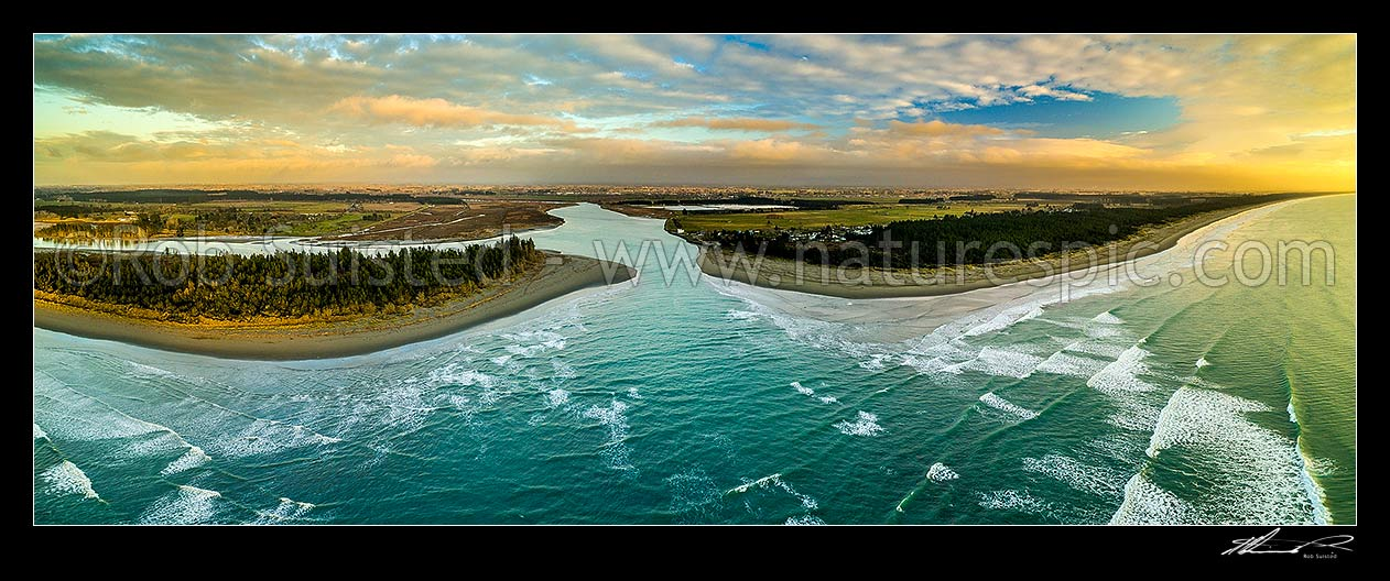 Image of Waimakariri River mouth at sunrise. Brooklands Lagoon at left, Kairaki and The Pines Beach at right, Canterbury plains beyond. Aerial panorama, Kaiapoi, Waimakariri District, Canterbury Region, New Zealand (NZ) stock photo image