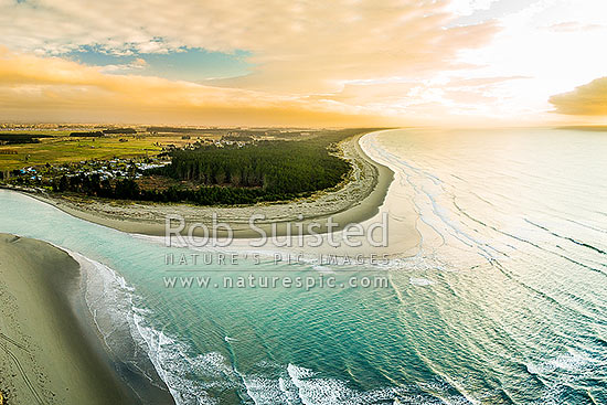 Waimakariri River mouth, looking north over Kairakai and The Pines Beach. Aerial view at dawn, Kaiapoi, Waimakariri District, Canterbury Region, New Zealand (NZ) stock photo.