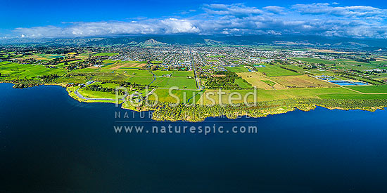 Lake Horowhenua, seen from western shore. Levin towhship and Horowhenua plains beyond, with Tararua Ranges above. Aerial panorama view, Levin, Horowhenua District, Manawatu-Wanganui Region, New Zealand (NZ) stock photo.