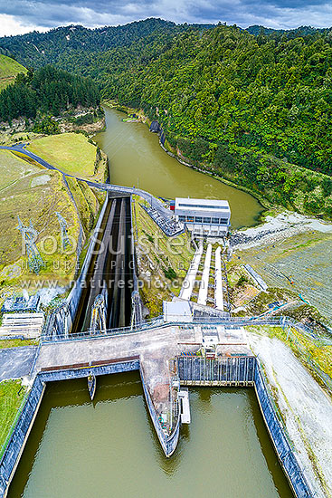 Patea Dam on the Patea River, holding back Lake Rotorangi, a 46km long hydro power lake.  Patea Dam is rated at 31 MW output, 80m high, and built 1984. Aerial view. Hurleyville, Patea, South Taranaki District, Taranaki Region, New Zealand (NZ) stock photo.