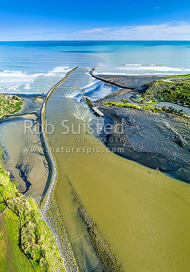 Patea River mouth, with training walls, breakwaters or moles.  South Taranaki Bight. Aerial view, Patea, South Taranaki District, Taranaki Region, New Zealand (NZ) stock photo.