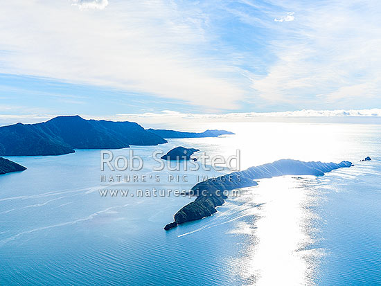 Outer Queen Charlotte Sound. Long Island (Kokomohua Marine Reserve) right, Motuara Island centre, and Cape Jackson behind. Aerial view, Marlborough Sounds, Marlborough District, Marlborough Region, New Zealand (NZ) stock photo.