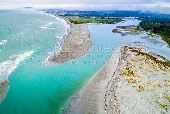Taramakau River mouth, estuary and sand bars. Aerial view looking north over surf, Kumara Junction, Westland District, West Coast Region, New Zealand (NZ) stock photo.