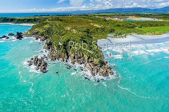 Tauranga Bay Beach (right) and Cape Foulwind Walkway. Aerial view, Cape Foulwind, Buller District, West Coast Region, New Zealand (NZ) stock photo.