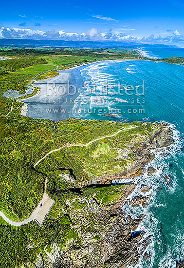 Cape Foulwind walkway and Tauranga Bay Beach. Aerial view looking south, Cape Foulwind, Buller District, West Coast Region, New Zealand (NZ) stock photo.