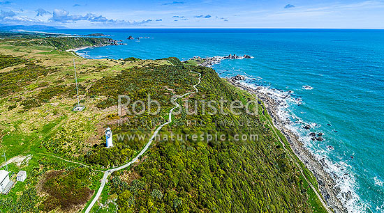 Cape Foulwind Lighthouse and Cape Foulwind Walkway track. Aerial panorama, Cape Foulwind, Buller District, West Coast Region, New Zealand (NZ) stock photo.