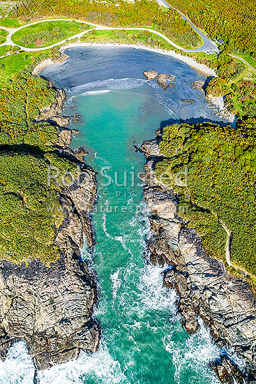 Constant Bay, an historic early harbour. Aerial view, Charleston, Buller District, West Coast Region, New Zealand (NZ) stock photo.