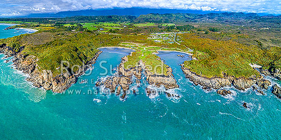 Charleston coastline. Joyce Bay and Constant Bay centre, with Little Beach and Nine Mile Beach far left, Doctors Bay far right. Charleston township beyond. Aerial panorama, Charleston, Buller District, West Coast Region, New Zealand (NZ) stock photo.