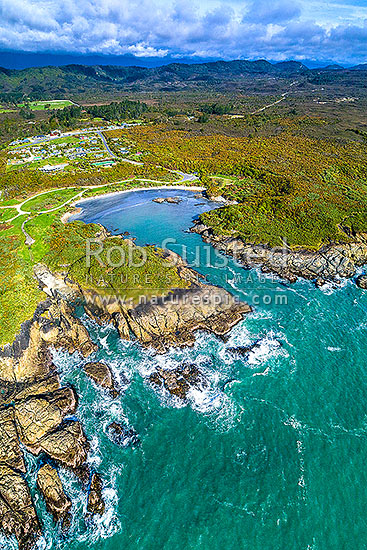 Constant Bay, an historic early harbour. Aerial view with Charleston township behind, Charleston, Buller District, West Coast Region, New Zealand (NZ) stock photo.