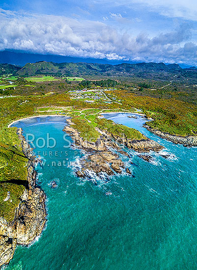 Charleston coastline. Joyce Bay (left) and Constant Bay, with Charleston township and Nile River beyond. Aerial view, Charleston, Buller District, West Coast Region, New Zealand (NZ) stock photo.