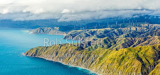 Meridian Energy Project West Wind farm of 62 turbines at Terawhiti Station and Makara Farm west of Wellington. Ohau Point and Opau Bay left. Cape Terawhiti, aerial panorama, Makara, Wellington City District, Wellington Region, New Zealand (NZ) stock photo.