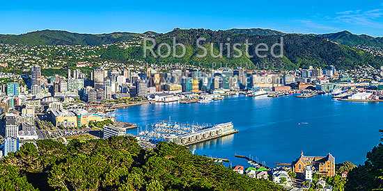 Wellington City CBD, Lambton Harbour, Port and hillside suburbs seen from Mt Victoria. Clyde Quay Wharf centre, and St Gerards Monastry lower right. Panorama, Wellington, Wellington City District, Wellington Region, New Zealand (NZ) stock photo.