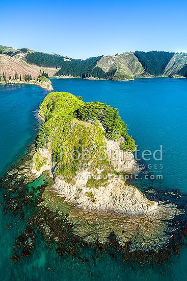 Horahora Kakahu Island, where local Maori Chiefs signed the Treaty of Waitangi in 1840. Marked by cairn visible. Whangatoetoe and Pipi Bays beyond. Aerial view, Port Underwood, Marlborough District, Marlborough Region, New Zealand (NZ) stock photo.